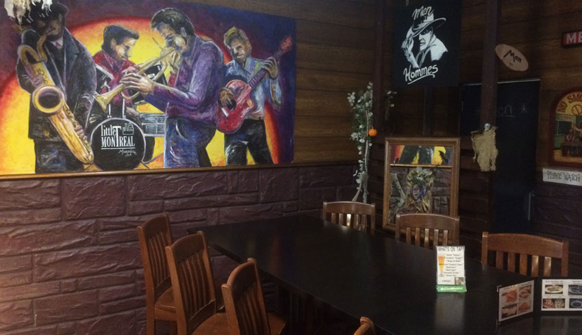 little-montreal-bar-deli-restaurant-sudbury-ontario-restaurant-tables-artwork-warm-atmosphere
