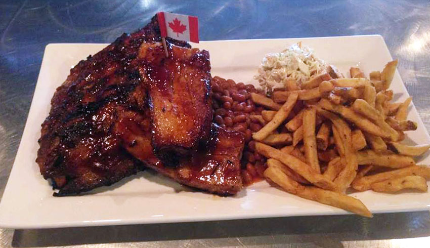 M.I.C.-BBQ-Platter-Half-Rack-of-Ribs-BBQ-Pork-Belly-baked-beans-french-fries-coleslaw-MIC-Canadian-Eatery-Restaurant-Sudbury-Ontario