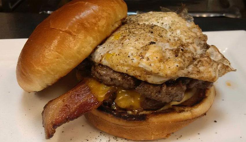 M.I.C.-The-Sunriser-Burger-two-4oz-sirloin-beef-patties-bacon-cheddar-mayo-over-easy-egg-on-briache-bun-MIC-Canadian-Eatery-Restaurant-Sudbury-Ontario