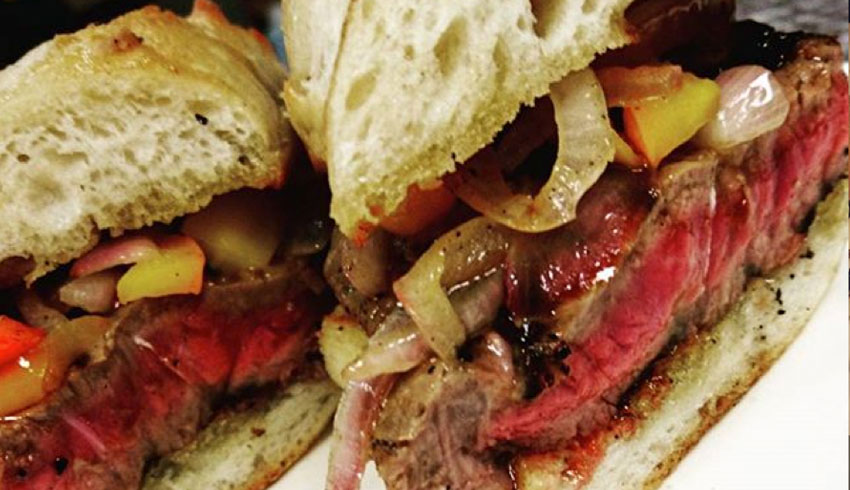 oscars-grill-sudbury-ontario-grilled-striploin-steak-sandwhich-sauteed-peppers-onions-grlic-toasted-baguette