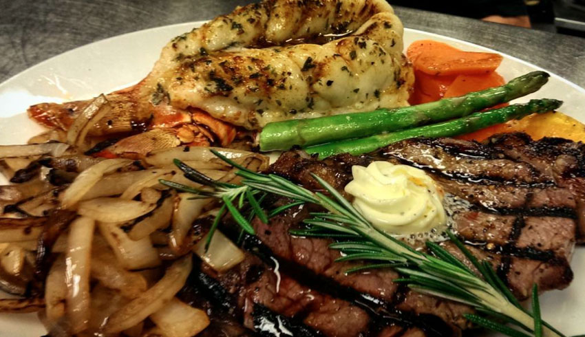 oscars-grill-sudbury-ontario-surf-and-turf-10oz-strip-loin-steak-atlantic-lobster-tail-caramelized-onions-sauteed-vegetables